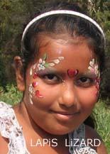 flowers and hearts face painting on ethnic girl