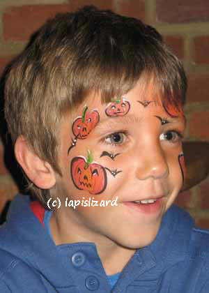 forehead and cheeks painted with small pumkins