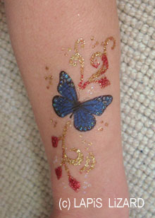 transfer butterfly with gold and red swirls on arm