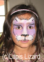 white and purple cat design on childs face