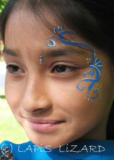 face painting blue swirls on Asian face in Oxford